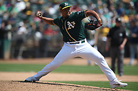 OAKLAND, CA - AUGUST 15:  Jeurys Familia #32 of the Oakland Athletics pitches against the Seattle Mariners during the game at the Oakland Coliseum on Wednesday, August 15, 2018 in Oakland, California. (Photo by Brad Mangin)