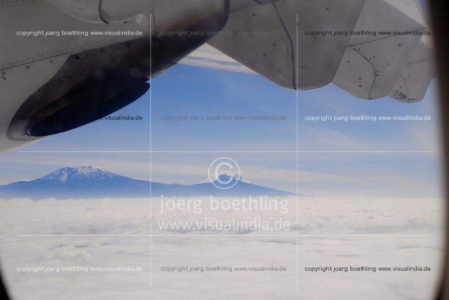 TANZANIA Mt. Kilimanjaro, snow covered and clouds, view from aircraft of Precision Air / TANSANIA , Blick aus Flugzeug auf den schneebedeckten Kilimanjaro und Wolkendecke