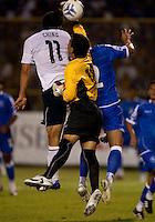 Brian Ching (11) goes up for the ball against Miguel Montes (18) during FIFA World Cup qualifier against El Salvador. USA tied El Salvador 2-2 at Estadio Cuscatlán Stadium in El Salvador on March 28, 2009.