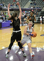 Fayetteville's Claudia Bridges (right) drives past Bentonville's Bella Irlenborn Friday, Jan. 17, 2020, during the first half of play in Bulldog Arena in Fayetteville. Visit nwaonline.com/prepbball/ for a gallery from the games.<br /> (NWA Democrat-Gazette/Andy Shupe)