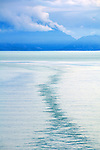 sky, sea & clouds all shades of blue as a ships wake can be seen in the waters off S Alaska