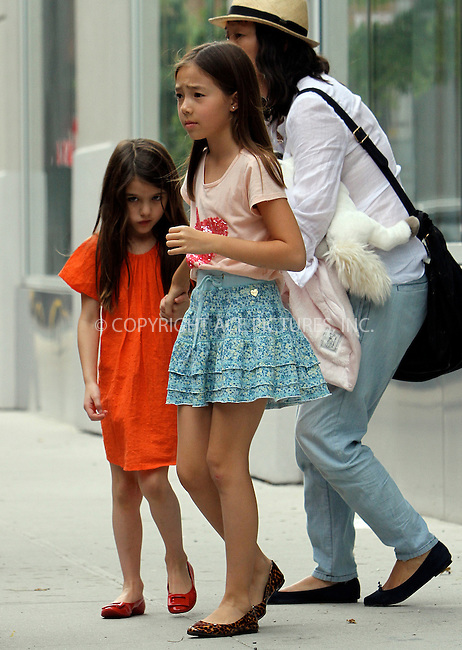 WWW.ACEPIXS.COM . . . . .  ....July 14 2012, New York City....Suri Cruise leaves the Children's Museum of Art with friends on July 14 2012 in New York City....Please byline: NANCY RIVERA- ACEPIXS.COM.... *** ***..Ace Pictures, Inc:  ..Tel: 646 769 0430..e-mail: info@acepixs.com..web: http://www.acepixs.com