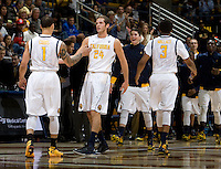 Ricky Kreklow of California slaps hands with Justin Cobbs during the game against Coppin State at Haas Pavilion in Berkeley, California on November 8th, 2013.    California defeated Coppin State, 83-64.