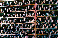 """A close-up of the wooden lasts stored in the """"last"""" room at Lobb the Bootmakers, high class cobblers in St.James's, London"""