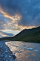 Midnight sun sets over the Marsh Fork of the Canning River, Brooks Range mountains, Arctic National Wildlife Refuge, Arctic, Alaska.