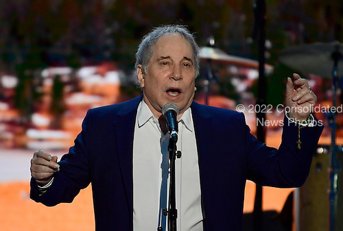 """Singer and songwriter Paul Simon performs """"Bridge over Troubled Water"""" at the 2016 Democratic National Convention at the Wells Fargo Center in Philadelphia, Pennsylvania on Monday, July 25, 2016.<br /> Credit: Ron Sachs / CNP<br /> (RESTRICTION: NO New York or New Jersey Newspapers or newspapers within a 75 mile radius of New York City)"""