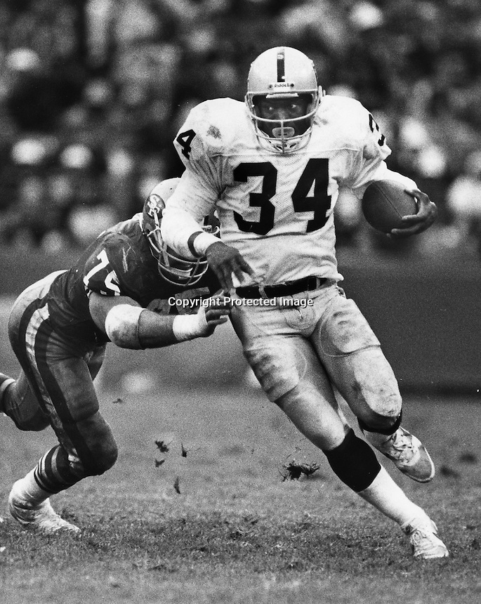 Raider running back Bo Jackson runs against the 49ers... 1988. Copyright/photo by Ron Riesterer