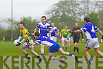 Gerard Farrelly of Annascaul attempts to block Finuge's  James Flaherty in the Credit Union County League Division 2 last Sunday in Finuge.