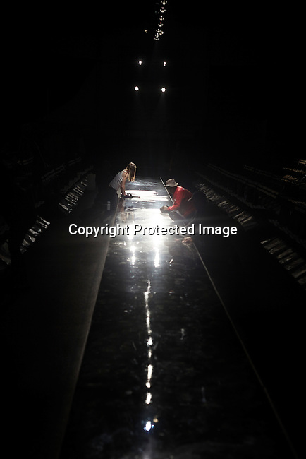 JOHANNESBURG, SOUTH AFRICA - SEPTEMBER 23: Workers clean a catwalk before a fashion show on 23, 2011, in Johannesburg, South Africa. (Photo by Per-Anders Pettersson)