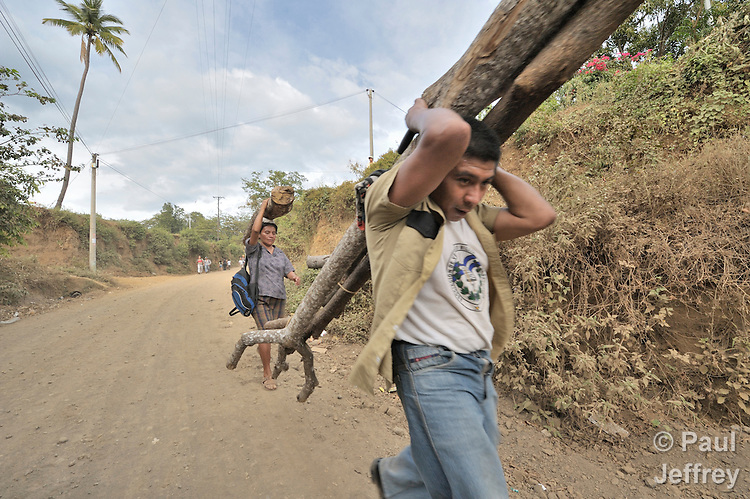 A man and woman carry home wood to be used for cooking in Santa Catarina Masahuat, El Salvador.