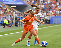 20190707 - LYON , FRANCE : American Tobin Heath pictured in a duel with Dutch Jackie Groenen during the female soccer game between The United States of America – USA-  and the Netherlands – Oranje Leeuwinnen -, the final  of the FIFA Women's  World Championship in France 2019, Sunday 7 th July 2019 at the Stade de Lyon  Stadium in Lyon  , France .  PHOTO SPORTPIX.BE | DAVID CATRY