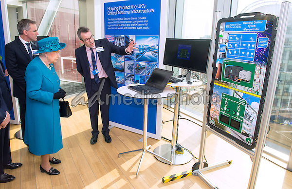 14 February 2017 - London, England - Director of Engagement and Advice Alex Dewdney (right) gives Queen Elizabeth II a demonstration of how an electricity supply could be subjected to cyber attack during the official opening of the National Cyber Security Centre (NCSC) in London. Photo Credit: ALPR/AdMedia