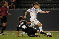 Los Angeles Galaxy midfielder (18) Kyle Martino is tackled by D. C. United defender (18) Devon McTavish at the Home Depot Center in Carson, CA on Wednesday, August 15, 2007..The Los Angeles Galaxy defeated D. C. United 2-0 in a SuperLiga semifinal match..