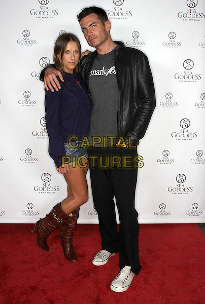 EDYTA SLIWINSKA & AIDEN TURNER .Gifting Services Honoring Season 10 Opener of Dancing with the Stars held At The CBS Studio Lot, Los Angeles, California, USA, .21st March 2010..full length black leather jacket arm around shirt  purple denim shorts grey gray t-shirt knee high brown boots converse trainers .CAP/ADM/KB.©Kevan Brooks/AdMedia/Capital Pictures.