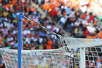 In the midst of a hotly contested match, a brid landed on the Danish net, getting a 'bird's eye view' of the action. Holland defeated Denmark, 2-0, June 14th, at Soccer City in the opening match of Group E of the 2010 FIFA World Cup.