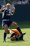 27 June 2004: Christie Welsh (22) of the New York Power jumps over Siri Mullinix (below) of the Washington Freedom during the 2004 WUSA Festival at the Home Depot Center in Carson, California.