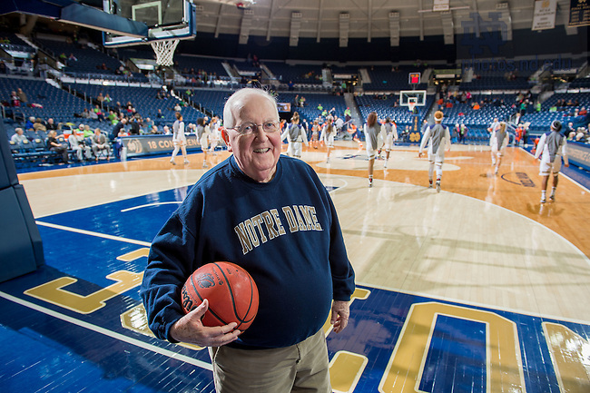 Feb. 5, 2015; MCOB professor Tom Harvey stands court side during warmups at a Women's Basketball game. (Photo by Matt Cashore/University of Notre Dame)