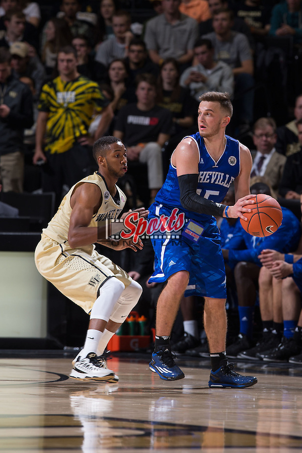 Andrew Rowsey (15) of the UNC Asheville Bulldogs is guarded by Madison Jones (1) of the Wake Forest Demon Deacons during second half action at the LJVM Coliseum on November 14, 2014 in Winston-Salem, North Carolina.  The Demon Deacons defeated the Bulldogs 80-69  (Brian Westerholt/Sports On Film)