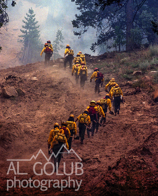 August 10, 1990 Yosemite National Park  --  A-Rock (Arch Rock) Fire  -- Fire crews from Fort Apache, Arizona hike to work the fireline. The Arch Rock Fire burned over 16,000 acres of Yosemite National Park and the Stanislaus National Forest.  At the same time across the Merced River, the Steamboat Fire burned over 5,000 acres of both Yosemite National Park and the Sierra National Forest.