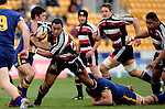Sekope Kepu is brought to a stop by Callum Bruce and Craig Newby during the Air NZ Cup game between Counties Manukau & Otago played at Mt Smart Stadium,Auckland on the 29th of July 2006. Otago won 23 - 19.