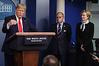 United States President Donald J. Trump speaks during a press conference with members of the coronavirus task force in the Brady Press Briefing Room of the White House on March 24, 2020 in Washington, DC.  At center is Director of the National Economic Council Larry Kudlow; and at right is Dr. Deborah L. Birx, White House Coronavirus Response Coordinator.<br /> Credit: Oliver Contreras / Pool via CNP/AdMedia