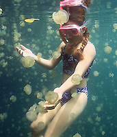 A girl swimming in the famous Jelly Fish Lake in Palau Micronesia