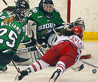Erika Lawler dives for the puck as the Badgers take on North Dakota in the first round of the WCHA playoffs at the Eagle's Nest in Verona Friday night