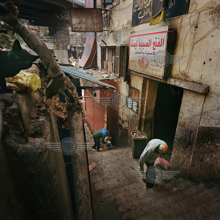 An elderly man walks up a flight of stairs in the Khan El Khalili district.