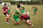 Kolo Vea looks to pass back to Rod Schubert as he is tackled near the touch line. Counties Manukau Premier Club Rugby Game of the Week between Drury & Papakura, played at Drury Domain on Saturday Aprill 11th, 2009..Drury won 35 - 3 after leading 15 - 5 at halftime.