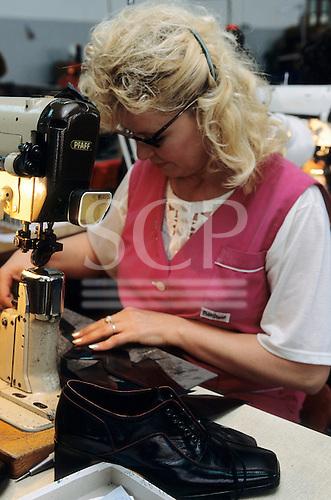 Serbia, Yugoslavia. Shoe factory; woman working on a machine.