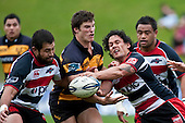 Tasesa Lavea tries to get the pass away to Graham Dewes  as Ed Jenkins does his best to be disruptive. Air New Zealand Cup Rugby Union match between Counties Manukau and Taranaki played at Growers Stadium, Pukekohe, on Saturday 23 August 2009..Photo: Richard Spranger/Photosport