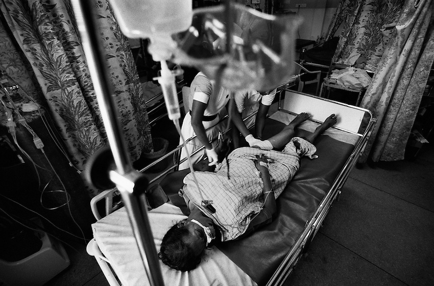 A Tamil woman wounded by a Claymore blast in Batticaloa district receives medical treatment at a hospital in Batticaloa, Sri Lanka, Sunday, Mar. 11, 2007. The blast, which was blamed on the Tamil Tigers, also severely wounded the woman's husband.