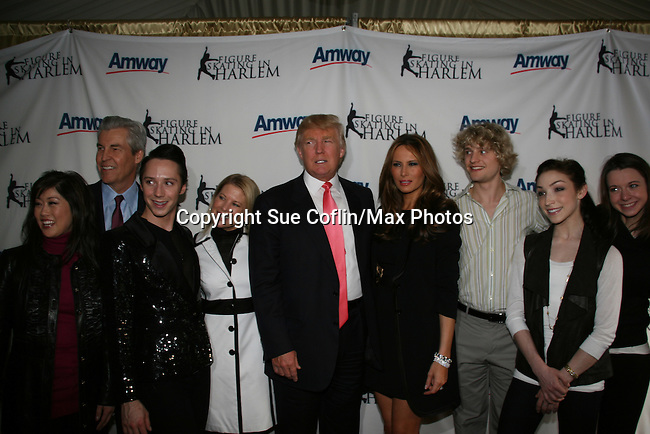 Donald & Melania & skaters at Skating with the Stars (celebrities & Olympic skaters), a benefit gala for Figure Skating in Harlem on April 6, 2010 at Wollman Rink, Central Park, New York City, New York. (Photo by Sue Coflin/Max Photos)