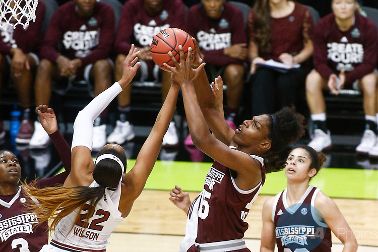 DALLAS, TX - APRIL 2: Teaira McCowan #15 of the Mississippi State Lady Bulldogs and A'ja Wilson #22 of the South Carolina Gamecocks reach for a rebound during the 2017 Women's Final Four at American Airlines Center on April 2, 2017 in Dallas, Texas. (Photo by Timothy Nwachukwu/NCAA Photos via Getty Images)