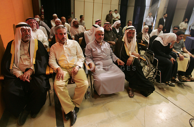 Palestinians from the war-ravaged  during a meeting for Palestinian parliament deputies against President Mahmoud Abbas' decision to withdraw support for a U.N. report that alleged Israel and Hamas committed war crimes in last winter's Gaza war, in the West Bank city of Ramallah, Monday, Oct. 5, 2009. Palestinian President Mahmoud Abbas faced growing outrage at home Sunday over his decision to withdraw support for a U.N. report that alleged Israel and Hamas committed war crimes in last winter's Gaza war. Photo by Naaman Omar