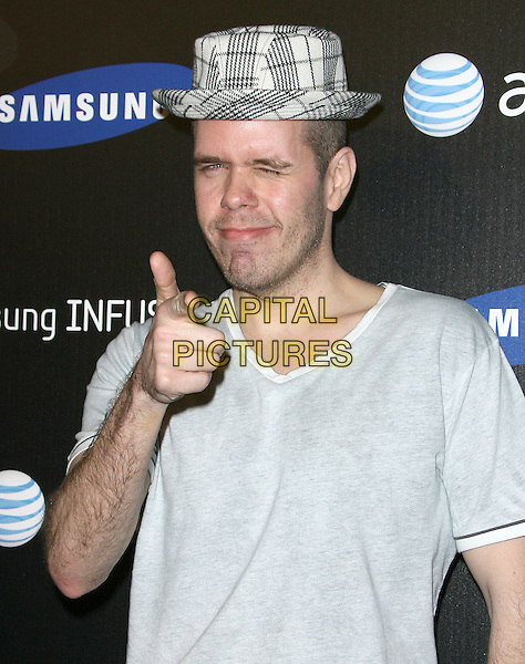 PEREZ HILTON.The Samsung Infuse 4G Launch Event  held at Milk Studios in Hollywood, California, USA..May 12th, 2011.half length white grey gray t-shirt plaid tartan hat hand thumb up smiling skinny thin weight loss.CAP/RKE/DVS.©DVS/RockinExposures/Capital Pictures.