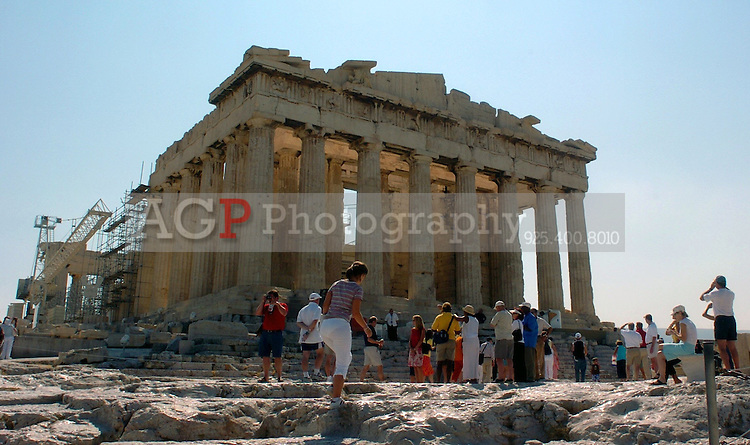 Aug 12, 2004 - Athens, CA, Greece - Tourists roam the grounds at the Acropolis in Athens, Greece Thursday August 12, 2004. The historic Acropolis is visible from most of the city. .(Credit Image: © Alan Greth/ZUMA Press)