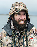 Guide Mark Vander Zanden with Four Flyways Outfitters collecting and hunting brant in Cold Bay, Alaska, Wednesday, November 2, 2016. The Izembek National Wildlife Refuge lies on the northwest coastal side of central Aleutians East Borough along the Bering Sea. Birds hunted include the long tailed duck, the Steller's Eider, the Harlequin, the King Eider and Brant.<br /> <br /> Photo by Matt Nager