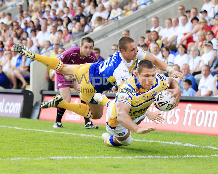Pix: Chris Mangnall /SWPix.com, Rugby League, Super League. 27/06/10 Warrington Wolves v Leeds Rhinos....picture copyright>>Simon Wilkinson>>07811267 706>>....Warrington's Chris Hicks fails to stop Leeds's 5th try scored by Ryan Hall