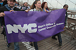 Activists march over the Brooklyn Bridge during the Denim Day 2016 rally from Brooklyn Borough Hall to City Hall in New York City on April 27, 2016.