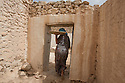 Morocco - Tidzi - Amina Hammoush, 40, carries the freshly toasted Argan seeds in her hand.