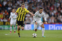 FUSSBALL  CHAMPIONS LEAGUE  HALBFINALE  RUECKSPIEL  2012/2013      Real Madrid - Borussia Dortmund                   30.04.2013 Sven Bender (li, Borussia Dortmund) gegen Mesut Oezil (re, Real Madrid)