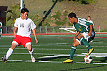 Redondo Beach, CA 02/01/10 - Masaya Kawauchi (Redondo Union #10) and Indheca Wycoff (Mira Costa #14) in action during the Bay League Boys Varsity Soccer game between Mira Costa and Redondo Union.