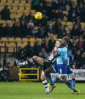 Anthony Stewart of Wycombe Wanderers battles Jonathan Stead of Notts Co during the Sky Bet League 2 match between Notts County and Wycombe Wanderers at Meadow Lane, Nottingham, England on 10 December 2016. Photo by Andy Rowland.