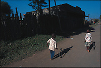 Children playing with hoop tires. Nakuru, Rhonda slum, Kenya.