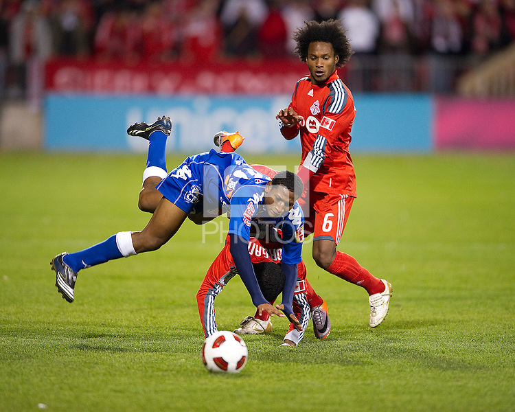 19 October 2010: Arabe Unido Felix Gondola #26 battles with Toronto FC Ashtone Morgan #36 and Toronto FC Julian De Guzman #6 during a CONCACAF game between Arabe Unido and Toronto FC at BMO Field in Toronto..Toronto FC won 1-0..