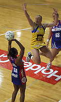 Pulse captain Cushla Lichtwark leaps to defend a shot from Pamlela Cookey during the ANZ Netball Championship match between the Central Pulse and Northern Mystics, TSB Bank Arena, Wellington, New Zealand on Monday, 4 May 2009. Photo: Dave Lintott / lintottphoto.co.nz