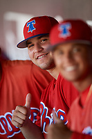 Philadelphia Phillies designated hitter Juan Aparicio (4) in the dugout during a Florida Instructional League game against the Toronto Blue Jays on September 24, 2018 at Spectrum Field in Clearwater, Florida.  (Mike Janes/Four Seam Images)