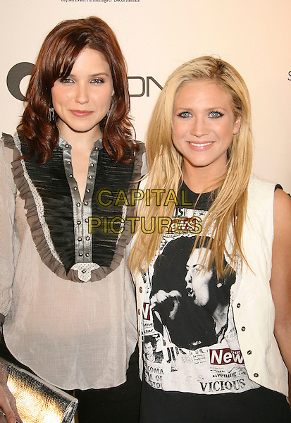 SOPHIA BUSH & BRITTANY SNOW.Lyric Culture Hosts Launch Party and Runway Show held at Avalon, Hollywood, California, USA, .10 May 2007..half length black blue skinny jeans white waistcoat shirt blouse .CAP/ADM/RE.©Russ Elliot/AdMedia/Capital Pictures.
