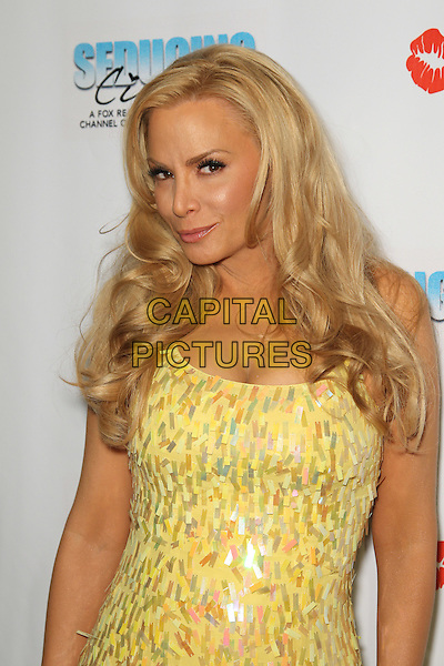 "CINDY MARGOLIS.Cast and friends of the hit Fox Reality series,  ""Seducing Cindy,"" arrive to the finale party at Guy's North. Studio City, CA, USA. .March 18, 2010.half length dress yellow paillettes.CAP/CEL.©CelPh/Capital Pictures."